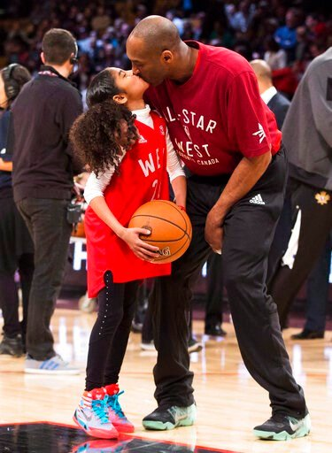 (Mark Blinch/The Canadian Press via AP). In this Feb. 14, 2016, file photo, Los Angeles Lakers Kobe Bryant (24) kisses his daughter Gianna on the court in warm-ups before first half NBA All-Star Game basketball action in Toronto. Bryant, his 13-year-ol...