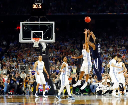 (AP Photo/David J. Phillip, File). FILE - In this April 4, 2016, file photo, Villanova's Kris Jenkins makes the game-winning three-point shot during the second half of the NCAA Final Four college basketball championship game against North Carolina, in ...