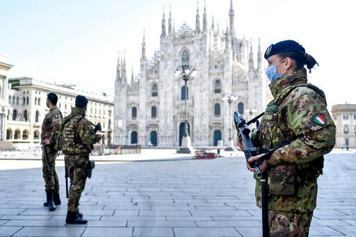 (Claudio Furlan/LaPresse via AP). Soldiers patrol in front of the Duomo gothic cathedral in Milan, Italy, Sunday, April 5, 2020. The government is demanding Italians stay home and not take the leveling off of new coronavirus infections as a sign the em...