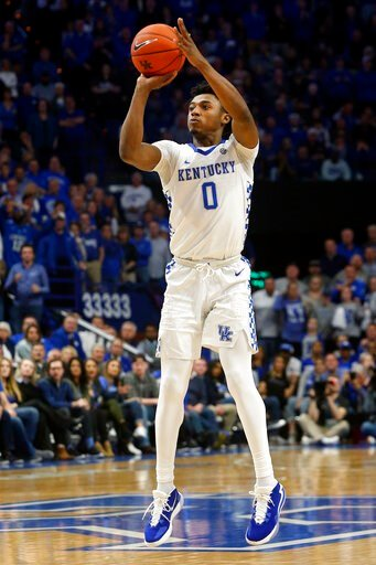 (AP Photo/James Crisp). Kentucky's Ashton Hagans takes an uncontested shot during the second half of the team's NCAA college basketball game against Tennessee, Tuesday, March 3, 2020, in Lexington, Ky. Tennessee won 81-73.