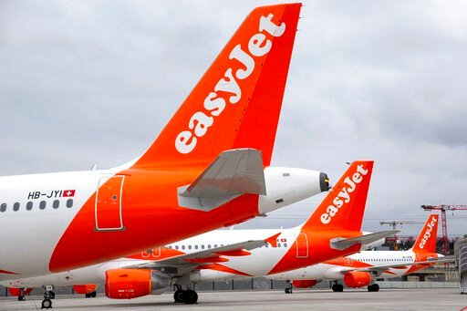 (Salvatore Di Nolfi/Keystone via AP). A large number of easyJet aircrafts are parked on the tarmac of the Geneve Aeroport, in Geneva, Switzerland, Monday, March 30, 2020. EasyJet, a British low-cost airline, on 30 March 2020 said it is ground its entir...