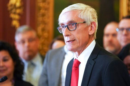 (Steve Apps/Wisconsin State Journal via AP, File). FILE - In this Feb. 6, 2020 file photo, Wisconsin Gov. Tony Evers holds a news conference in Madison, Wis. Wisconsin Democratic Gov. Tony Evers' administration is moving ahead with plans to buy 10,000 ...