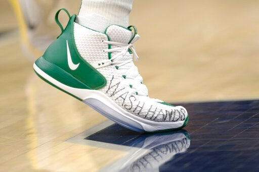 """(AP Photo/AJ Mast). Boston Celtics center Enes Kanter wears shoes with """"wash hands"""" written on them during the second half of the team's NBA basketball game against the Indiana Pacers in Indianapolis, Tuesday, March 10, 2020. The Celtics won 114-111."""