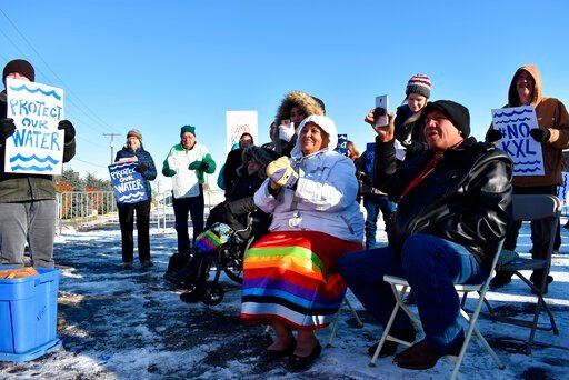 (AP Photo/Matthew Brown, File). FILE - In this Oct. 29, 2019 file photo, opponents of the Keystone XL oil pipeline from Canada demonstrate in sub-freezing temperatures in Billings, Mont. Alberta is investing $1.1 billion in the disputed Keystone XL pip...