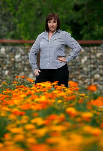 (AP Photo/Ross D. Franklin). Arizona caterer Pat Christofolo, who owns Artisan by Santa Barbara Catering as well as The Farm at South Mountain, pauses at a large garden on property at The Farm has had business drop off due to the coronavirus shown here...