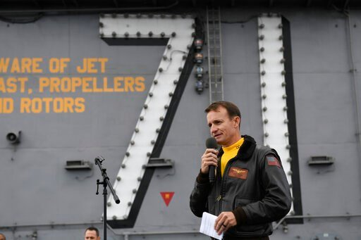 (U.S. Navy Photo by Mass Communication Specialist 3rd Class Nicholas Huynh via AP). In this Nov. 15, 2029, photo U.S. Navy Capt. Brett Crozier, commanding officer of the aircraft carrier USS Theodore Roosevelt (CVN 71), addresses the crew during an all...
