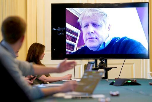 (Andrew Parsons/10 Downing Street via AP, File). FILE - In this Saturday, March 28, 2020 handout photo provided by Number 10 Downing Street, Britain's Prime Minister Boris Johnson chairs the morning Covid-19 Meeting remotely after self isolating after ...