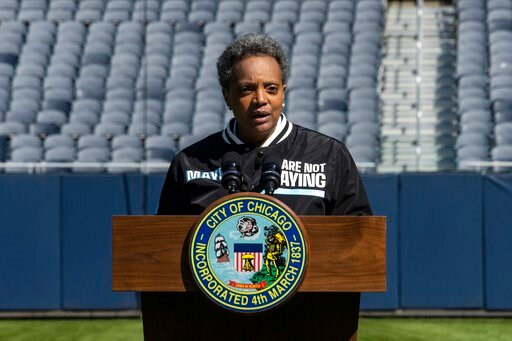 "(Ashlee Rezin Garcia/Chicago Sun-Times via AP). Mayor Lori Lightfoot announces the ""We Are Not Playing"" campaign during a press conference at Soldier Field, Monday morning, April 6, 2020, in Chicago. The city is launching a health campaign focused on t..."
