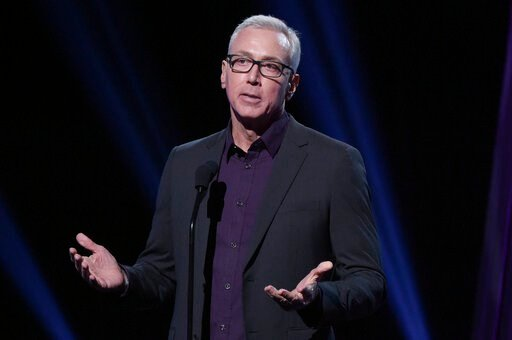 (Photo by Richard Shotwell/Invision/AP, File). FILE - This Jan. 18, 2019 file photo shows Drew Pinsky speaking at the 2019 iHeartRadio Podcast Awards in Burbank, Calif. Pinsky has apologized for a series of statements unspooled in a recent video where ...