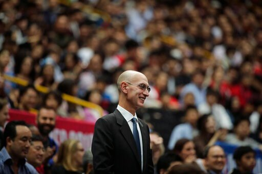 (AP Photo/Jae C. Hong, File). FILE - In this Oct. 8, 2019 file photo, NBA Commissioner Adam Silver is introduced during an NBA preseason basketball game between the Houston Rockets and the Toronto Raptors in Saitama, near Tokyo.  Silver said in an inte...