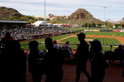 (AP Photo/Darron Cummings). Fans watch a spring training baseball game between the Los Angeles Angels and the San Diego Padres, Thursday, Feb. 27, 2020, in Tempe, Ariz.