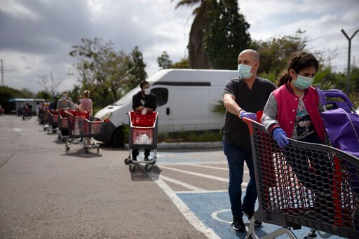 (AP Photo/Oded Balilty). Customers wear face masks as they line up to enter a supermarket keeping social distancing following the government's measures to help stop the spread of the coronavirus, in Tel Aviv, Israel, Tuesday, April 7, 2020. Israeli Pri...