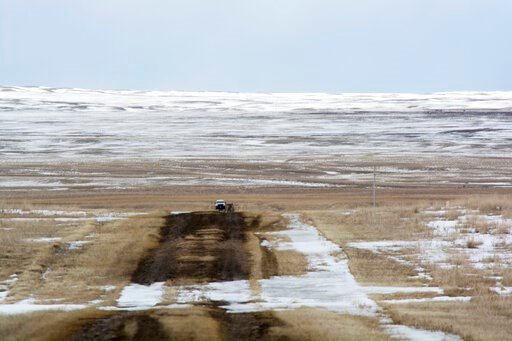 (Al Nash/Bureau of Land Management via AP). This March 11, 2020 photo provided by the Bureau of Land Management shows the proposed route of the Keystone XL oil pipeline where it crosses into the U.S. from Canada in Phillips County, Mont. A Canadian com...