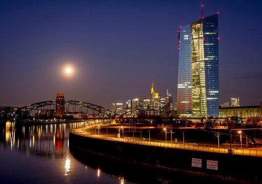 (AP Photo/Michael Probst). A nearly full moon sets over the buildings of the banking district and the European Central Bank, right, in Frankfurt, Germany, early Tuesday, April 7, 2020. Due to the coronavirus the economy worldwide expects heavy losses.