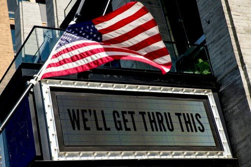 """(AP Photo/Andrew Harnik). In this April 6, 2020 photo, a sign at The Anthem music venue reads """"We'll Get Thru This"""" at the wharf which is almost completely empty because of the coronavirus outbreak in Washington. The coronavirus pandemic has gut-punche..."""