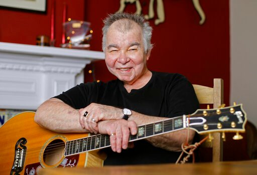 (AP Photo/Mark Humphrey, File). FILE - In this June 20, 2017 file photo, John Prine poses in his office in Nashville, Tenn. Prine died Tuesday, April 7, 2020 from complications of the coronavirus. He was 73.