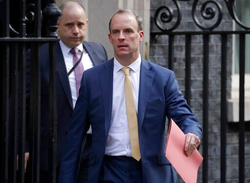 (AP Photo/Matt Dunham). Britain's Secretary of State for Foreign Affairs, Dominic Raab, leads cabinet members as they leave 10 Downing Street after a meeting as British Prime Minister Boris Johnson was moved to intensive care after his coronavirus symp...