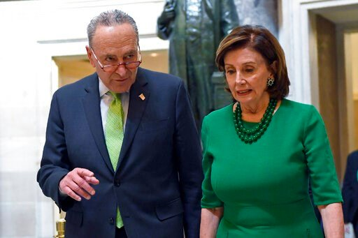 (AP Photo/Susan Walsh, File). FILE - In this March 12, 2020, file photo Senate Minority Leader Sen. Chuck Schumer of N.Y., and House Speaker Nancy Pelosi of Calif., walks together as they head to a lunch with Irish Prime Minister Leo Varadkar on Capito...
