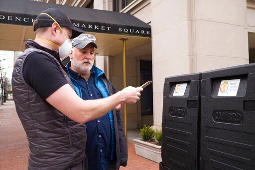(Mike Jett/World Central Kitchen via AP). In this March 31, 2020 photo made available by World Central Kitchen, Chef Jose Andres, right, and Nate Mook discuss meal distribution to first responders in Washington, DC. Andres, whose 30-plus restaurants in...