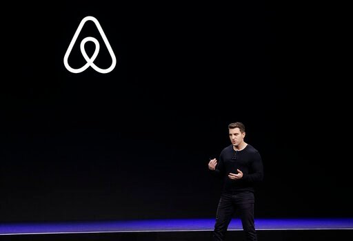 (AP Photo/Eric Risberg, File). FILE - In this Feb. 22, 2018, file photo Airbnb co-founder and CEO Brian Chesky speaks during an event in San Francisco.   Just as the coronavirus outbreak has boxed in society, it's also squeezed high-flying tech compani...