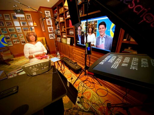 """(CBS via AP). This image released by CBS shows Gayle King of """"CBS This Morning"""" broadcasting from her home. More than most news programs, morning shows on ABC, CBS and NBC thrive by fostering a sense that its personalities are a chummy family. Now, due..."""