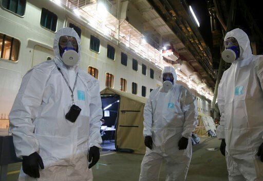 (Nathan Patterson/NSW Police via AP). In this Wednesday, April 8, 2020, photo provided by the New South Wales Police, investigators in protective gear prepare to board the Ruby Princess cruise ship at Wollongong, Australia. Police boarded the cruise sh...