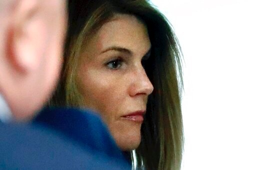 (AP Photo/Steven Senne, File). FILE - In this Aug. 27, 2019, file photo, Lori Loughlin enters through the back door at federal court in Boston for a hearing in a nationwide college admissions bribery scandal. Federal prosecutors in a legal document fil...