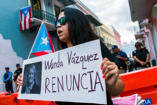 (AP Photo/Dennis M. Rivera Pichardo). Protesters gather outside the government mansion La Fortaleza in San Juan, Puerto Rico, Wednesday, Aug. 7, 2019, calling for the removal of the island's newly sworn-in governor, ex-Justice Secretary Wanda Vazque